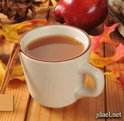 مشروب التفاح الساخن منكهه بقشر البرتقال والقرفه