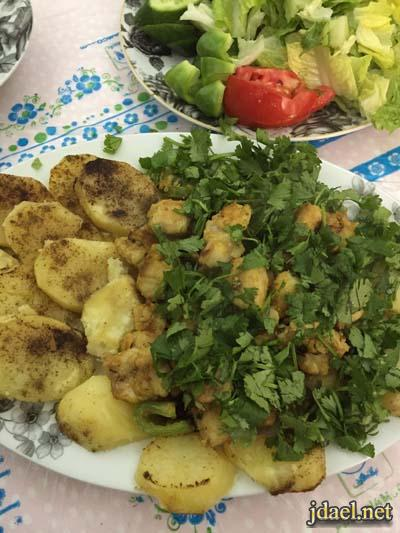 صينية سمك وشرائح البطاطس بالكمون الفرن