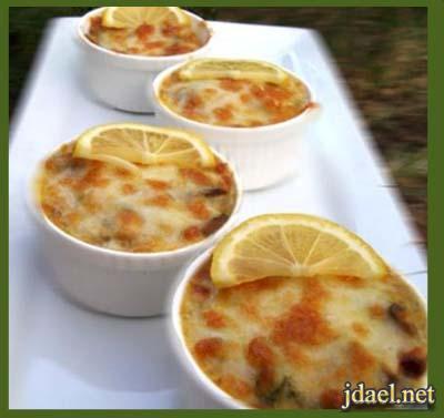صينية بطاطس طبقات بالدجاج والقشطة والجبن الفرن