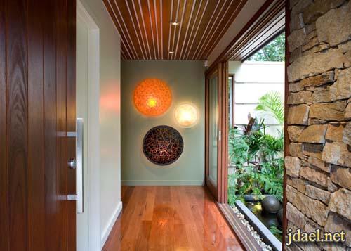ديكورات فخمة بالحجر بتركيب فريد على جدران الغرف والممرات
