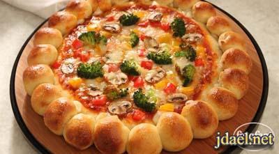 طريقة عمل بيتزا باطراف خلية النحل بالجبن الموزاريلا
