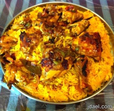 ارز بالزعفران وقطع دجاج بالخضار بطعم حامض بالفرن