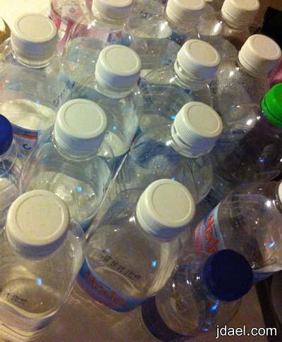 توزيعات افراح ومواليد مبتكره بقوارير الماء بفساتين الدانتيل والشرايط