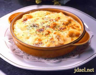 ارز بالجمبري مع الصلصه البيضاء وجبن بارميزان بالفرن