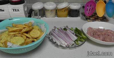 طريقة عمل صينية البطاطس بالقشدة وصدور الدجاج اطباق الفرن