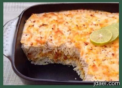صينية ارز بالدجاج بخلطة الجبن السائل والقشطه بالفرن