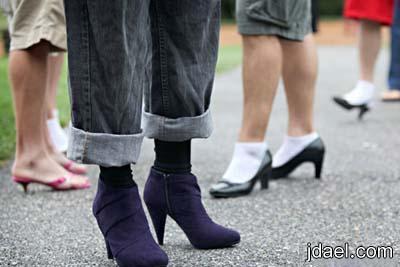 اغرب الصور كندا استعراض رجالي بلبس الكعب العالي تضامنا المراه
