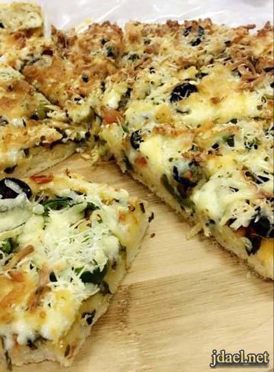 طريقة عمل اسهل عجينة البيتزا لتحضير بيتزا بالسبانخ ومجموعة اجبان