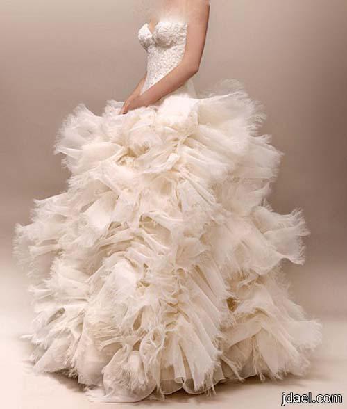 فساتين العروسه ليلة الزفاف بتصاميم مشغوله بفخامة التطريز ونوعية القماش
