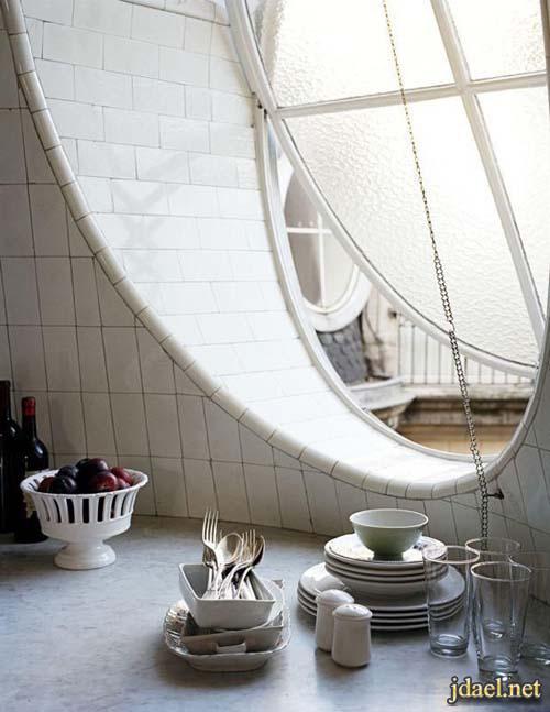 تصاميم نوافذ دائريه بافكار روعه الزجاج والخشب للتصميم الداخلي